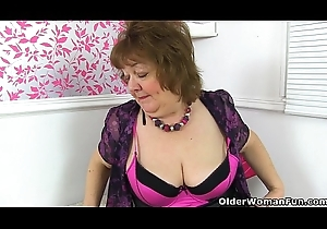 British granny Susan feeds her hot to trot bawdy cleft with vibrator