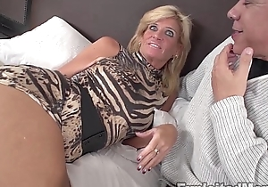 Off colour golden-haired milf gets fucked wide of coal-black dong in non-professional interracial pellicle